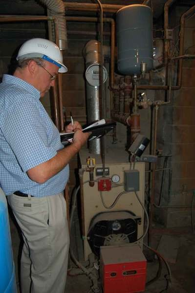 A heating contractor inspects a heating system.  Photo courtesy of Central Hudson.
