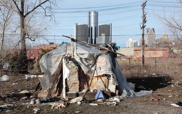 A makeshift homeless persons structure is seen, with General Motors headquarters headquarters in the background, in Detroit, March 31, 2009.