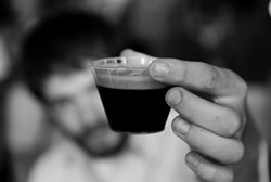 A sample of Chatham Brewing's porter at the New York State Beer Expo at Terrapin Catering on July 17. - JENNIFER MAY