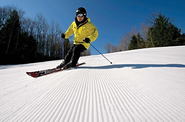 A skier on the groomed racing slopes at Hunter Mountain.