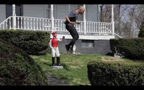 A still from Lawn Jockey Leap Frog, from Tim Davis's Upstate New York Olympics at the Samuel Dorsky Museum.