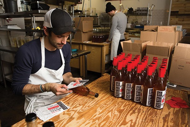 All Drink More Good syrup bottles - are labeled by hand. - KAREN PEARSON