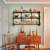 Kingston's First Mini-Mansion American folk art collection: Shaker Pembroke table—Adirondack Chair wooden bear was a gift of famed designer Tom Gunkelman. Paint color: C2 Artichoke . Deborah DeGraffenreid