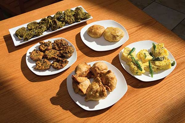 Appetizers clockwise from top left: patra pinwheel; khasta kachori; khaman; samosas; spinach pakora - KAREN PEARSON