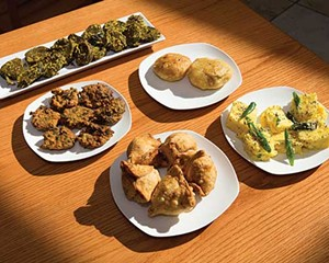 Appetizers clockwise from top left: patra pinwheel; khasta kachori; khaman; samosas; spinach pakora
