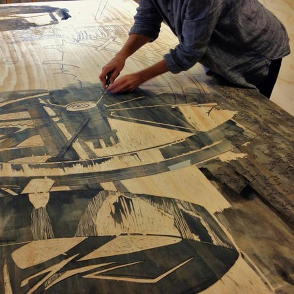 Artist preparing woodcut for Steamroller. - CARINDA SWANN
