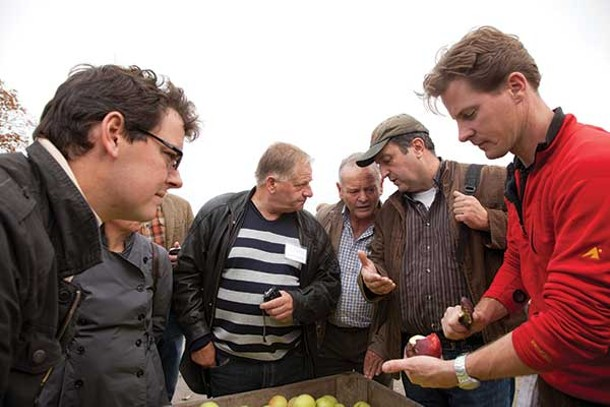 As part of Glynwood's 2011 Apple Exchange, apple growers from the Le Perche region of Normandy, France, visit Derek Grout of Harvest Spirits (pictured extreme right) in Valatie. - SARA FORREST