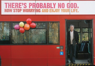 "Author Richard Dawkins, who wrote ""The God Delusion,"" stands on a bus in London at the launch of an atheist advertising campaign on January 6, 2009. Photo by Reuters/Andrew Winning."