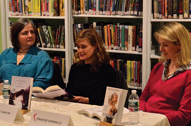 Authors Maya Gold and Jennifer Donnelly listen as Kimberly Sabatini reads from her book during the Hudson Valley YA (Young Adult) Society panel discussion at the 2nd Annual Read Local! Red Hook Literary Festival.