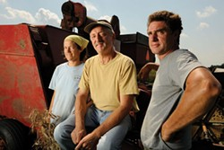 Baker Don Lewis, center, of Wild Hive Farm. Jeanine Connolly (left), and Alton Earnhart (right) of Lightning Tree Farm grow the wheat milled by Lewis. - JENNIFER MAY