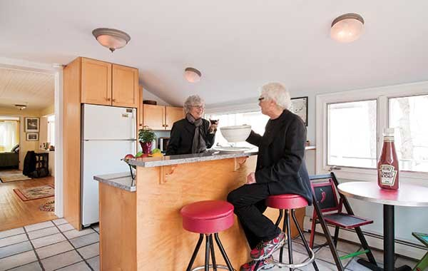 Barbara Pokras and Bob Malkin in their kitchen with some - Think Big! products: giant cup/saucer and ketchup bottle.