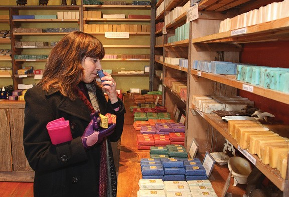 Beth Kalet of Warwick samples some of the handmade soaps available at Rosner Soaps in Sugar Loaf. - ADAM FERNANDEZ