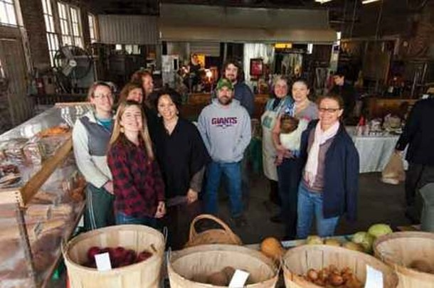Betsy Mccall (front left) and the farmers of the Millerton Winter Farmers' market. - STEFFEN THALEMANN