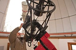 Bob Antol adjusting his Ritchey-Chrétien telescope. - DEBORAH DEGRAFFENREID