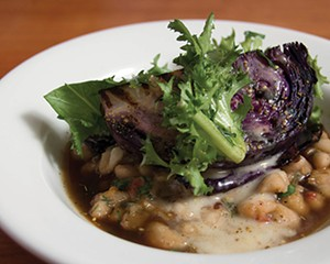 Braised and grilled red cabbage, cannellini beans, and onion broth.