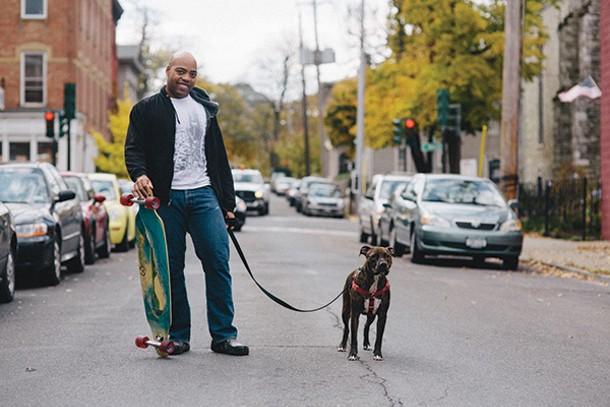 Brett Morton and his dog Spider in Hudson. - THOMAS SMITH