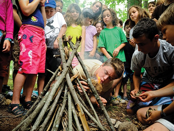 Building the perfect campfire at Wild Earth. - MAGGIE HEINZEL-NEEL