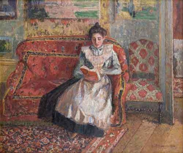 "Camille Pissarro, Cocotte, Reading, oil on canvas, 1899. The exhibition ""Pissarro's People"" will be on display at the Clark Art Institute through October 2. Collection of Ann and Gordon Getty."