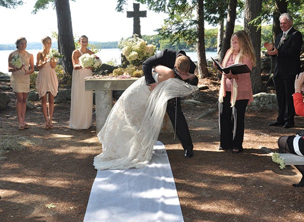Celebrant Amy Benedict officiates a wedding on Bear Island in Lake Winnipesaukee in New Hampshire. - KEITH SLINEY