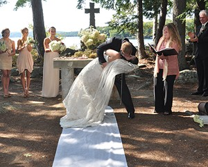 Celebrant Amy Benedict officiates a wedding on Bear Island in Lake Winnipesaukee in New Hampshire.