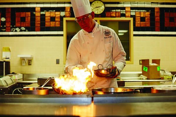 Chef Martin Matysik cooking at the CIA's new pop-up restaurant, Pangea. - KAREN PEARSON