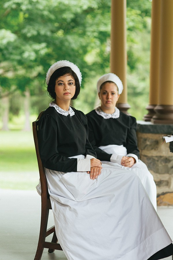 Cheyenne and Chelsie await their next group at Historic Huguenot Street, where they give tours. - THOMAS SMITH