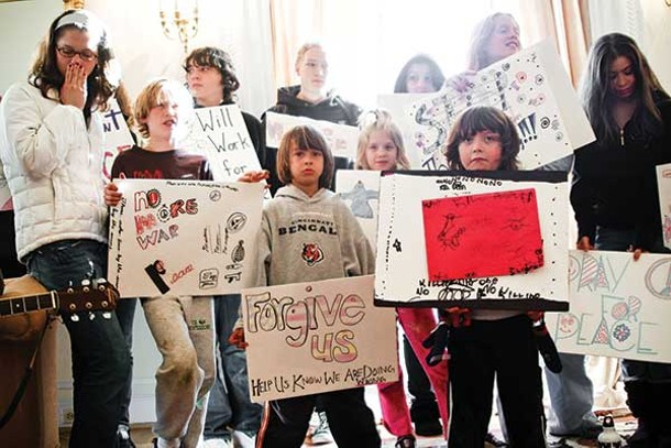 Children delivering messages of peace to the - Afghanistan Embassy in Washington, DC, on December 29, 2008. - SCOTT LANGLEY