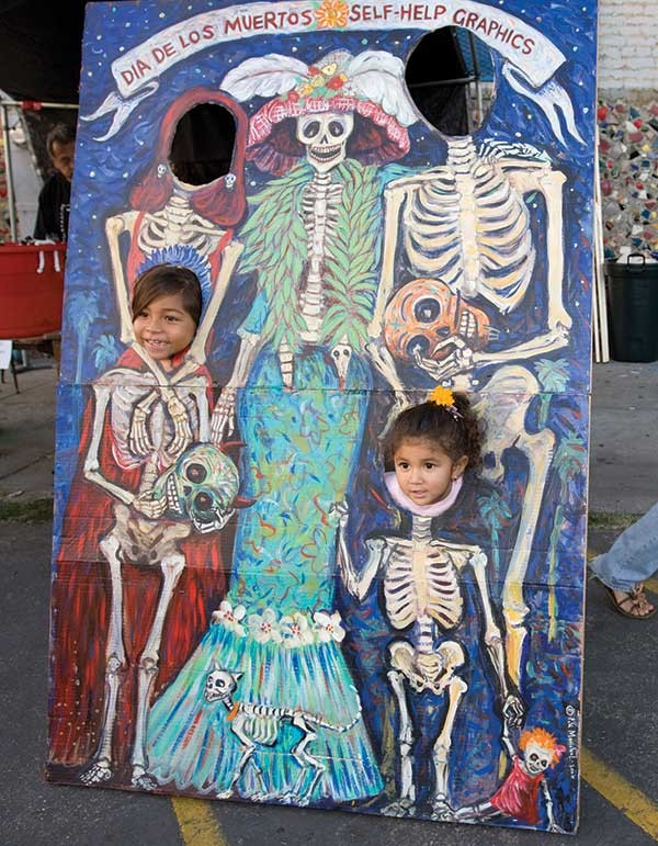 """Children have their picture taken during a celebration of the Day of the Death or """"Dia de los Muertos"""" in Los Angeles."""