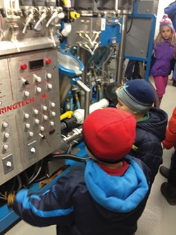 Children ogling the industrial-sized, state-of-the-art reverse osmosis machine at - Madava Farms, home of Crown Maple syrup, in Dover Plains.