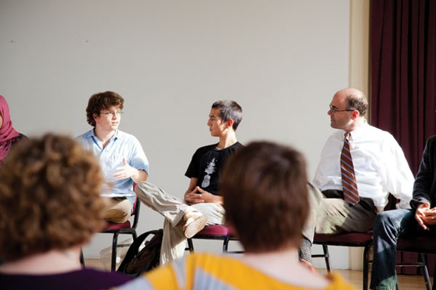 Community Council representatives discuss issues, organizations, and campus activities with Provost Peter Laipson.