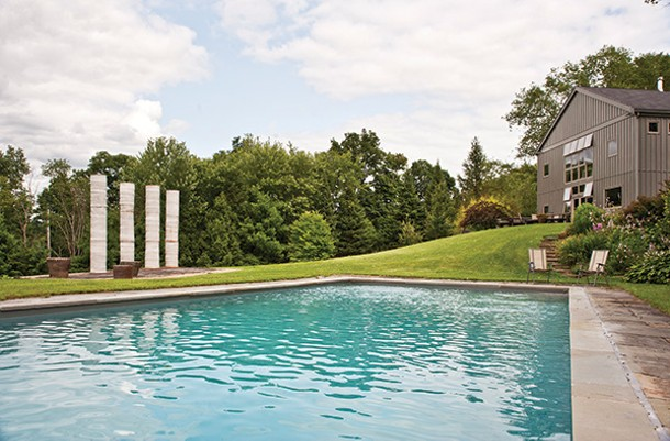 Created by Chaleff to celebrate the couple's wedding in 2007, the four-piece sculpture, Eleven Eleven, defines the front landscape. - DEBORAH DEGRAFFENREID
