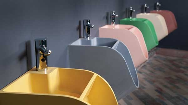 Designer Kaspars Jursons's latest invention: an environmentally friendly urinal-sink unit which uses the water from the sink to flush the toilet.