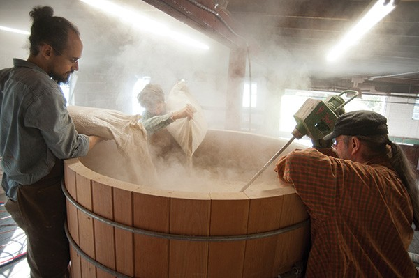 Distillery Manager Christopher Williams, assistant Sam Zurofsky and Master Distiller Angus MacDonald starting a rye whiskey mash. - ROY GUMPEL