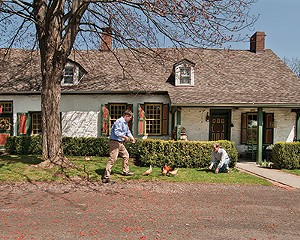 Eddie Cattuzo and Robert Sweeney with the bantams in front of the 1751 Benjamin Ten Broek House