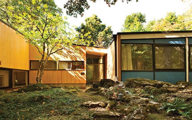 """Entryway to the house—note opaque glass obscuring view of the interior. The panels to the right are painted """"Breuer Blue."""" - DEBORAH DEGRAFFENREID"""