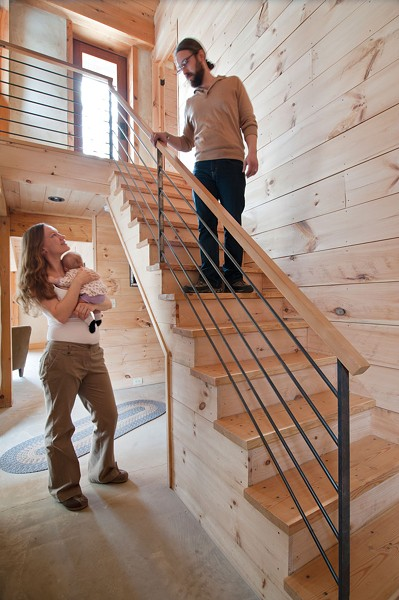 Environmentally friendly white pine was used throughout the house. The railing was fabricated by a local craftsman. - DEBORAH DEGRAFFENREID