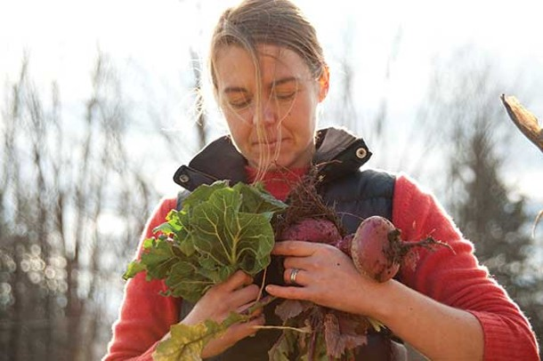 Erin Enouen, Hudson Valley Seed Library sales manager, with Scarlet Ohno Revival Turnips. - ROY GUMPEL