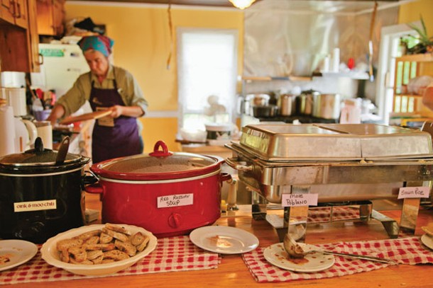 Farmer Carol Clement prepares lunch at the Bee's Knees Café at Heather Ridge Farm in Preston Hollow.