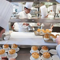 The Bocuse Restaurant Final preparation of the truffle soups before they are delivered to diners. Jennifer May