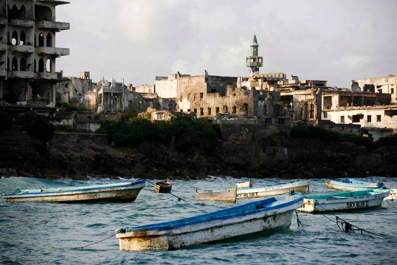Fishing boats float on a harbor in front of Mogadishu's Hamarweyne district, July 28, 2007.