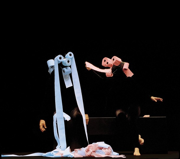 Floriana Frassetto and Pietro Montandon of Mummenschanz performing a signature piece with toilet paper masks. - PIA ZANETTI