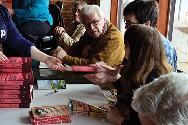 """Frank Delaney talks with Owen King and Kelly Braffet at a book signing after their panel """"Telling Stories: Conversations With Fiction Writers"""" at the 2nd Annual Read Local! Red Hook Literary Festival."""
