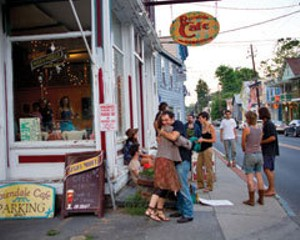 Friends greet each other in front of the Rosendale Cafe before the Baby Gramps performance in June.