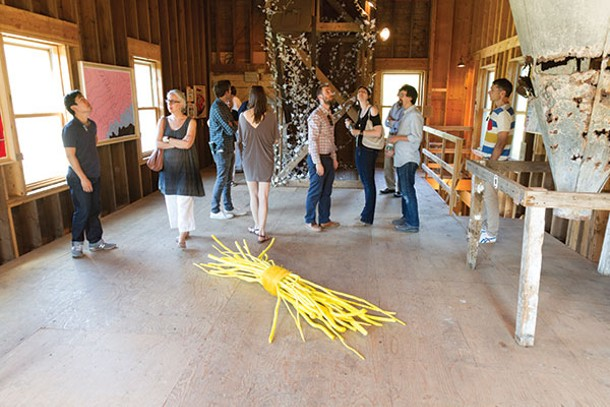 "From the Wassaic Project 2013 summer exhibition ""Homeward Found"" preview party held on June 15. In the foreground, Tora Lopez's Two Cheers For The Bundle Of Sticks Metaphor. In the background, the ivy wrapped around the wooden structure is Gi"