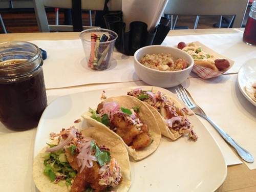 Gluten-free fish tacos, quinoa salad, and a hot dog with guacamole and chipolte cream