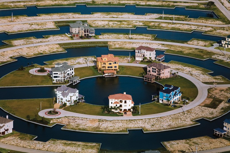 Harborwalk is a planned waterfront community built on wetlands on the western coast of Galveston Bay. In the coming century this land will be some of the most vulnerable on the Texas coast to sea-level rise, yet developers continue to construct low-lying waterfront homes.