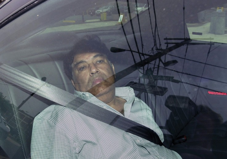 Hemant Lakhani is driven by FBI agents into the Federal Courthouse in Newark, New Jersey on August 13, 2003. lakhani was convicted of providing material support to terrorists and illegal weapons dealing after being ensnared in a government sting operation, and is serving a 30-year prison sentence.