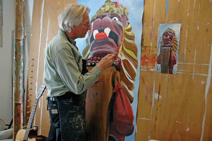 Hendrik Dijk paints Figure Head 1, which will be hung from lower Broadaway streetlights in June for the Quadricentennial celebrations. - The banner shows the figurehead of the Zeven Provincieen, a replica of a 17th-century Dutch ship presently being built in Holland.