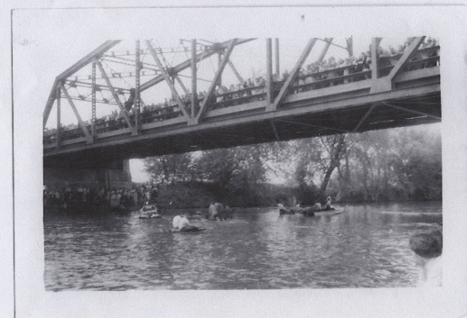 Historical photo of the New Paltz Regatta on the Wallkill River and spectators on the Carmine Liberta Bridge - COURTESY OF THE NEW PALTZ REGATTA