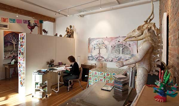 In the foreground, a sculpture by Tanya Kukucka, recently added to the art collection. Painting on wall, Gathering Forces, by Linda Marston-Reid. On bookshelf, rooster and crow paper-mache sculptures by renowned Mexican sculptor Saulo Moreno. - DEBORAH DEGRAFFENREID